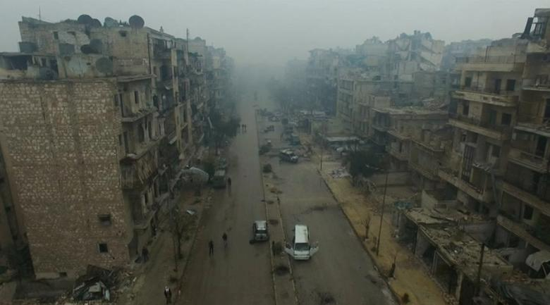 A still image from video taken December 13, 2016 of a general view of bomb damaged eastern Aleppo, Syria in the rain. REUTERS/via ReutersTV