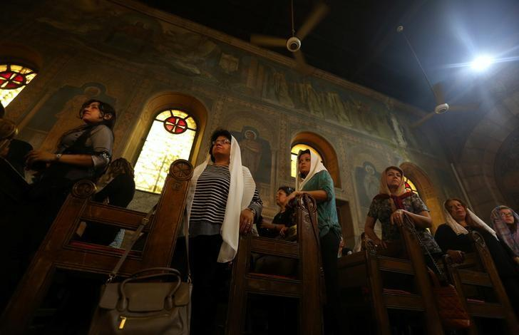Relatives of the Christian victims of the crashed EgyptAir flight MS804 attend an absentee funeral mass at the main Cathedral in Cairo, Egypt, May 22, 2016. REUTERS/Mohamed Abd El Ghany/Files