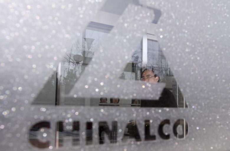 An employee of Aluminum Corp of China walks inside the company's headquarters in Beijing March 26, 2010.   REUTERS/Christina Hu/File Photo