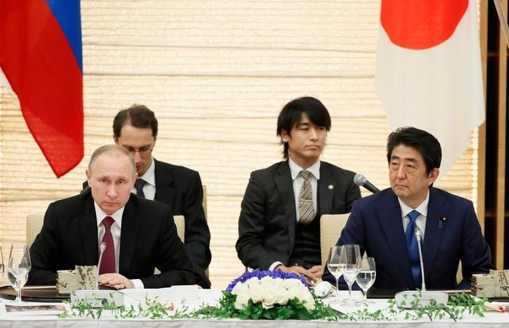 Russian President Vladimir Putin and Japanese Prime Minister Shinzo Abe attend a working lunch in Tokyo, Japan, Friday, Dec. 16, 2016. REUTERS/Alexander Zemlianichenko/Pool