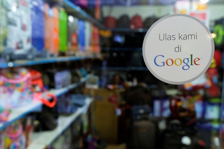 A sticker reading 'Review us on Google' is pictured at a smartphone shop in Ambassador Mall in Jakarta, Indonesia, September 19, 2016. REUTERS/Beawiharta/File Photo