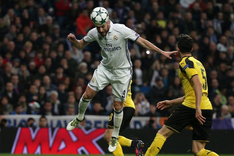 UEFA Champions League - Santiago Bernabeu stadium, Madrid, Spain - 7/12/16 Real Madrid's Karim Benzema scores during the match. REUTERS/Juan Medina