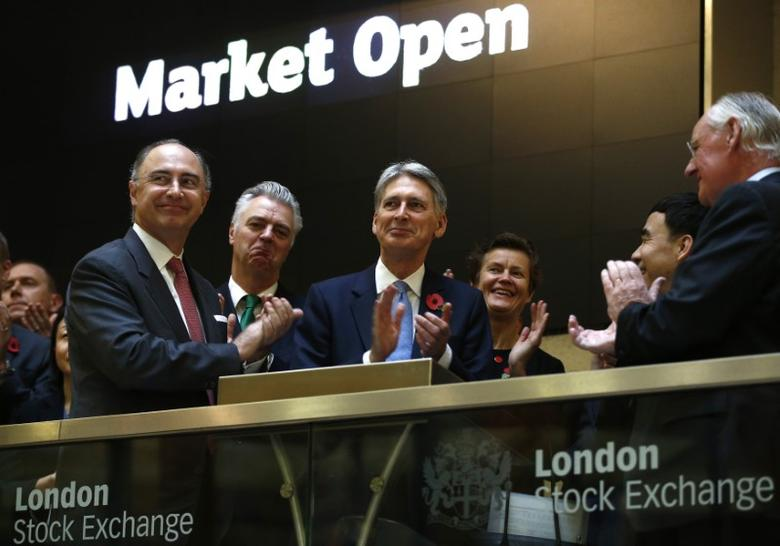 Britain's Chancellor of the Exchequer Philip Hammond (3rd L), opens the London Stock Exchange with Xavier Rolet, CEO (L) and joined by a banking and financial delegation from China, London, Britain November 10, 2016.  REUTERS/Peter Nicholls