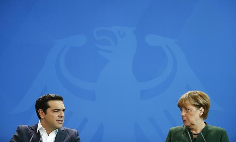 German Chancellor Angela Merkel and Greek Prime Minister Alexis Tsipras give a statement at the chancellery in Berlin, Germany, December 16, 2016.      REUTERS/Fabrizio Bensch