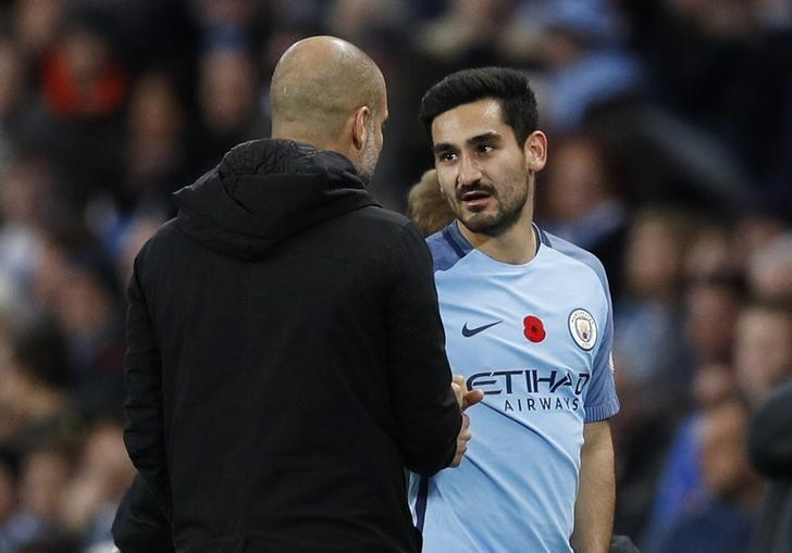 Britain Football Soccer - Manchester City v Middlesbrough - Premier League - Etihad Stadium - 16/17 - 5/11/16 Manchester City manager Pep Guardiola with Ilkay Gundogan Reuters / Darren Staples/ Files