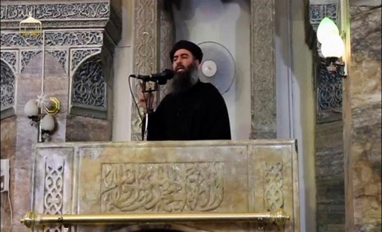 A man purported to be the reclusive leader of the militant Islamic State Abu Bakr al-Baghdadi making what would have been his first public appearance, at a mosque in the centre of Iraq's second city, Mosul, according to a video recording posted on the Internet on July 5, 2014, in this still image taken from video.  REUTERS/Social Media Website via Reuters TV/File Photo