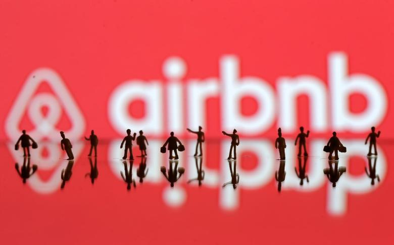A 3D printed people's models are seen in front of a displayed Airbnb logo in this illustration taken, June 8, 2016. REUTERS/Dado Ruvic/Illustration TPX IMAGES OF THE DAY      - RTSGKJ0