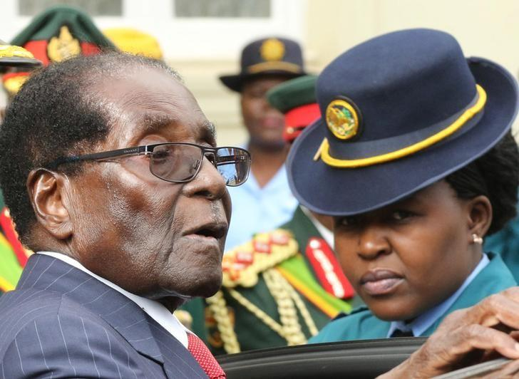 President Robert Mugabe leaves after delivering his State Of the Nation address at Parliament in Harare, Zimbabwe, December 6, 2016.   REUTERS/Philimon Bulawayo