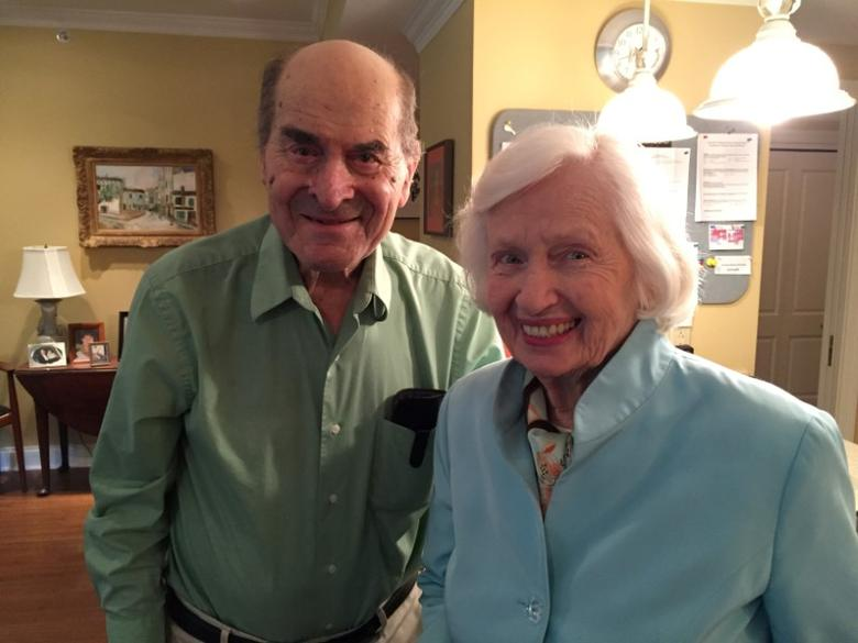 Dr. Henry Heimlich (L), the 96-year-old Cincinnati surgeon credited with inventing the life-saving technique named for him, poses with Patty Ris, 87, who he saved this week from choking on a hamburger, at the Deupree House seniors