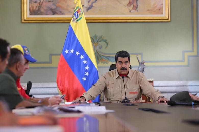Venezuela's President Nicolas Maduro speaks during a meeting with ministers at Miraflores Palace in Caracas, Venezuela December 17, 2016. Miraflores Palace/Handout via REUTERS