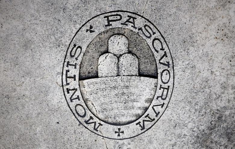 A logo of Monte dei Paschi di Siena bank is seen on the ground in Siena, Italy, November 5, 2014. REUTERS/Giampiero Sposito/File Photo
