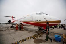An ARJ21-700, China's first domestically produced regional jet, arrives at Shanghai Hongqiao Airport after making its first flight from Chengdu to Shanghai, China June 28, 2016. REUTERS/Aly Song/File Photo