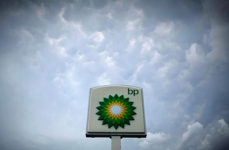 Storm clouds form near a BP station in Alexandria, Virginia July 19, 2010. REUTERS/Molly Riley/File Photo