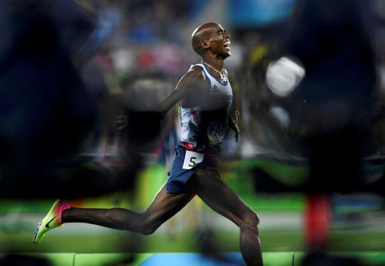 2016 Rio Olympics - Athletics - Final - Men's 5000m Final - Olympic Stadium - Rio de Janeiro, Brazil - 20/08/2016. Mo Farah (GBR) of Britain celebrates winning the race. REUTERS/Dylan Martinez