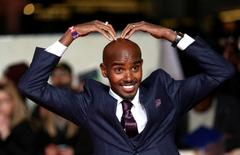 """Athlete Mo Farah poses for photographers at the world premiere of the film """"I am Bolt"""" in London, Britain November 28, 2016. REUTERS/Neil Hall"""