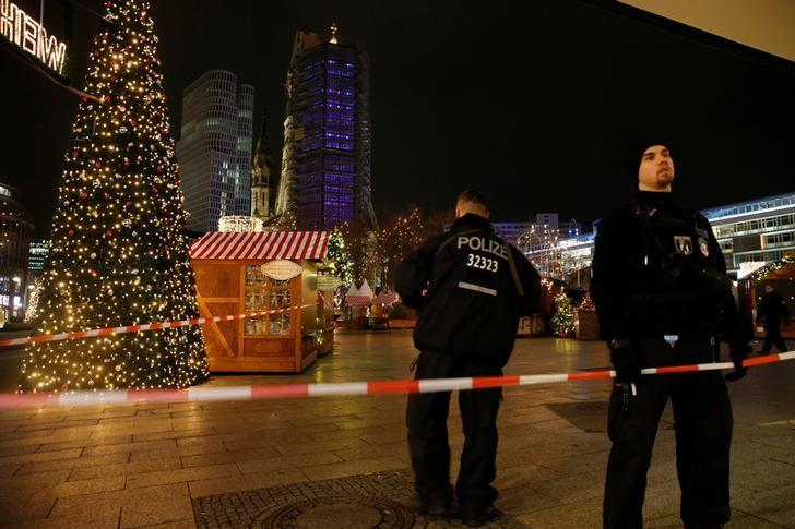 Police secures the area at the site of an accident at a Christmas market on Breitscheidplatz square near the fashionable Kurfuerstendamm avenue in the west of Berlin, Germany, December 19, 2016.   REUTERS/Fabrizio Bensch