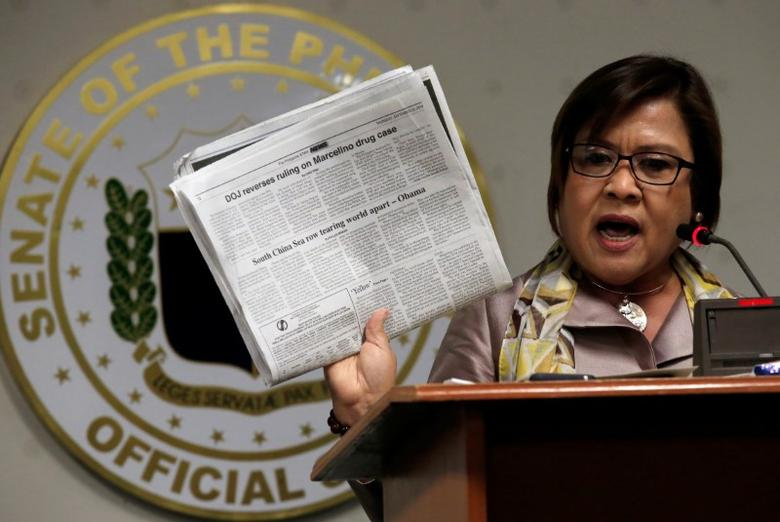 Former Justice Secretary and current Senator Leila De Lima shows reporters an article published on a local newspaper during a news conference at the Senate headquarters in Pasay city, metro Manila, Philippines September 22, 2016. REUTERS/Romeo Ranoco/Files