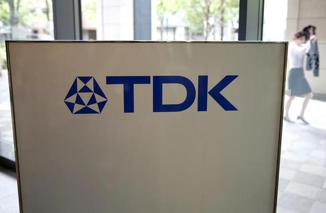 The logo of TDK Corp. is displayed at the entrance of the company headquarters building in Tokyo, Japan, July 6, 2016. REUTERS/Issei Kato
