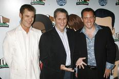 "Matt Stone (L) and Trey Parker (R), creators of the television animated series ""South Park"", pose with Doug Herzog, president of Comedy Central, at the South Park The Tenth Season party in Los Angeles September 21, 2006. REUTERS/Fred Prouser"