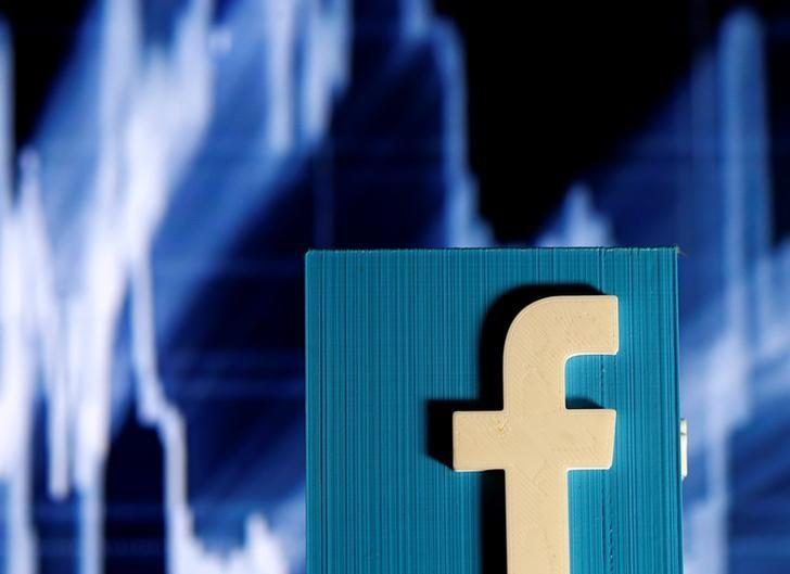 A 3D-printed Facebook logo is seen in front of a displayed stock graph in this illustration taken November 3, 2016.  REUTERS/Dado Ruvic/Illustration - RTX2RSLT