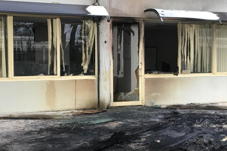 The damaged entrance to the offices of the Australian Christian Lobby Group in Canberra, Australia, December 22, 2016 after it was rammed by a van reportedly carrying gas bottles.   AAP/Belinda Merhab/via REUTERS