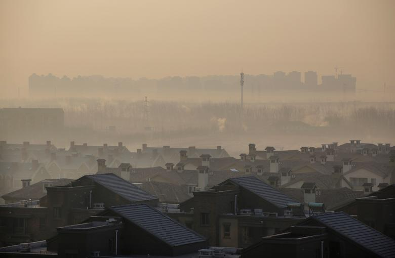 Apartment blocks are pictured on a hazy day in Wuqing district of Tianjin, China, December 10, 2016. REUTERS/Jason Lee