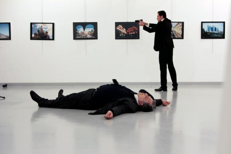 Russian Ambassador to Turkey Andrei Karlov lies on the ground after he was shot by unidentified man at an art gallery in Ankara, Turkey, December 19, 2016. Hasim Kilic/Hurriyet via REUTERS