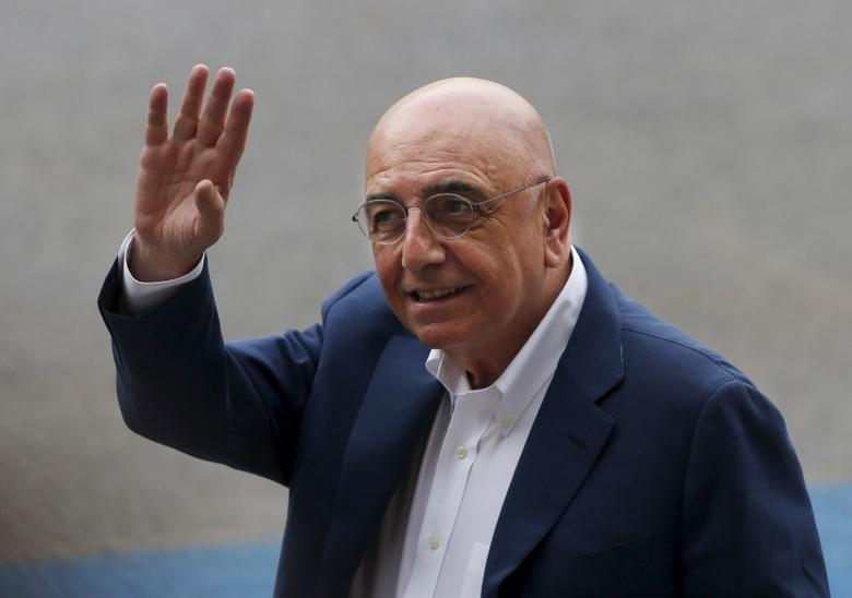 Italian entrepreneur and AC Milan vice-president and CEO Adriano Galliani waves to Chinese fans during a training session in Shenzhen, China July 24, 2015. REUTERS/Bobby Yip