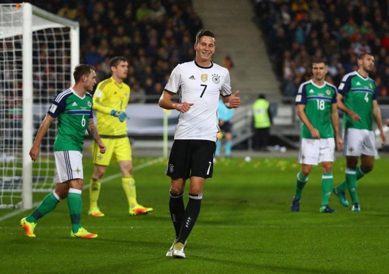 Germany's Julian Draxler celebrates scoring their first goal Reuters / Kai Pfaffenbach