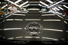 The logo of Volkswagen company is seen on a car on an assembly line at the Volkswagen car factory in Palmela, Portugal, December 9, 2016.   REUTERS/Rafael Marchante - RTX2UTGC