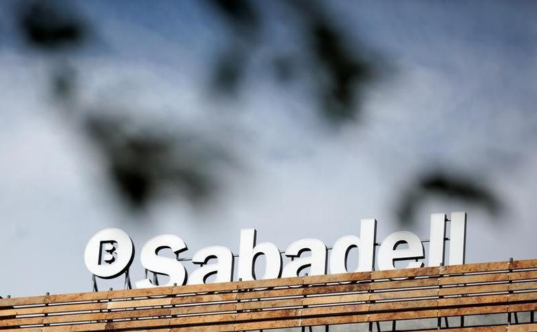 The Banco Sabadell logo can be seen behind leaves on top of a building outside Madrid, Spain, April 13, 2016. REUTERS/Andrea Comas