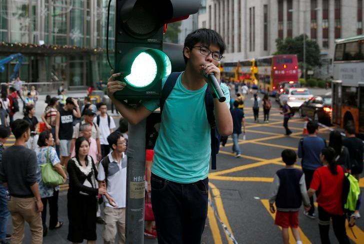 Pro-democracy activist Joshua Wong shouts during a protest against what they call Beijing's interference over local politics and the rule of law a day before China's parliament is expected to announce their interpretation of the Basic Law in light of two pro independence lawmakers' oath-taking controversy in Hong Kong, China November 6, 2016. REUTERS/Tyrone Siu/Files