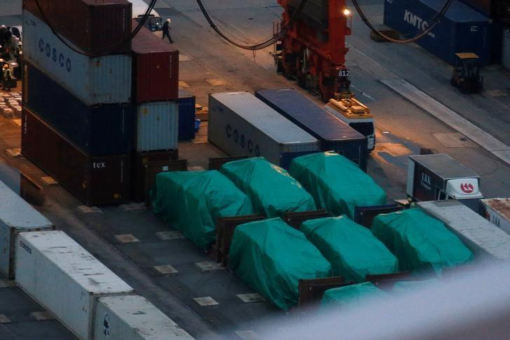 Six of the nine armoured troop carriers belonging to Singapore, from a shipment detained at a container terminal, are seen in Hong Kong, China November 24, 2016.  REUTERS/Bobby Yip/File Photo