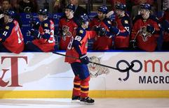 Jan 3, 2016; Sunrise, FL, USA; Florida Panthers right wing Jaromir Jagr (68) is congratulated by teammates after his game winning goal in the third period of a game against the Minnesota Wild at BB&T Center.  Robert Mayer-USA TODAY Sports