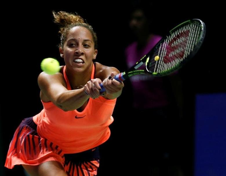 Tennis - Singapore WTA Finals Round Robin Singles - Singapore Indoor Stadium, Singapore - 27/10/2016 - Madison Keys of the U.S. in action against Angelique Kerber of Germany    REUTERS/Edgar Su