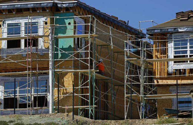 A worker works at the construction site of a new home in Carlsbad, California September 22, 2014.     REUTERS/Mike Blake