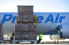 Workers unload a wide body aircraft emblazoned with Amazon's Prime logo at Lehigh Valley International Airport in Allentown, Pennsylvania, U.S. December 20, 2016. Picture taken December 20, 2016. REUTERS/Mark Makela