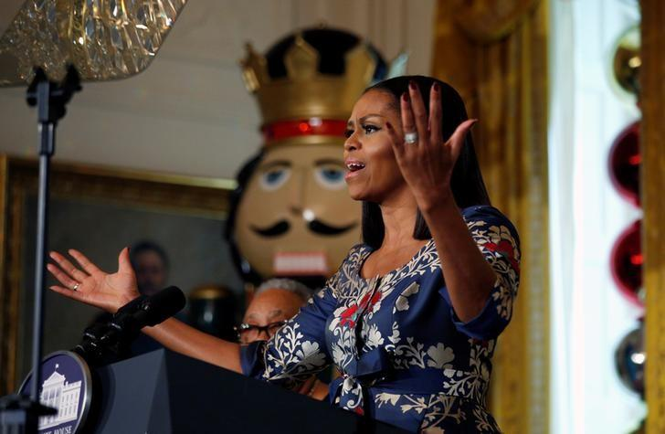 First lady Michelle Obama speaks during an event welcoming military families to the White House to view the holiday decorations in Washington, U.S., November 29,  2016.  REUTERS/Kevin Lamarque