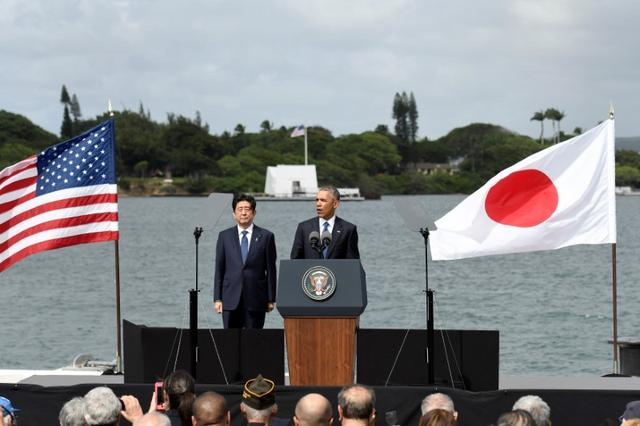 U.S. President Barack Obama and Japanese Prime Minister Shinzo Abe give remarks at Kilo Pier overlooking the USS Arizona Memorial at Joint Base Pearl Harbor-Hickam in Honolulu, Hawaii, U.S. December 27, 2016. REUTERS/Hugh Gentry