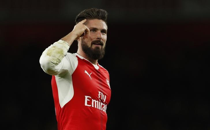 Britain Soccer Football - Arsenal v West Bromwich Albion - Premier League - Emirates Stadium - 26/12/16 Arsenal's Olivier Giroud celebrates after the game  Action Images via Reuters / John Sibley Livepic