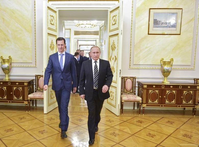 Russian President Vladimir Putin (R) and Syrian President Bashar al-Assad enter a hall during a meeting at the Kremlin in Moscow, Russia, October 20, 2015. Alexei Druzhinin/RIA Novosti/Kremlin/via REUTERS/File Photo