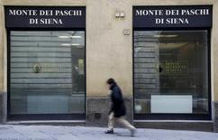 A man walks in front of the Monte dei Paschi bank in Siena, central Italy, January 29, 2016. REUTERS/Max Rossi