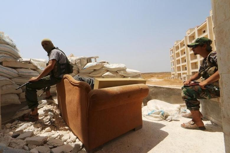 Nusra Front fighters rest with their weapons behind sandbags in the Sheikh Maksoud neighbourhood of Aleppo, Syria  August 3, 2015. REUTERS/Abdalrhman Ismail/File Photo