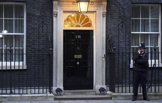 FILE PHOTO: A police officer stands on duty in the early morning light outside 10 Downing Street in London, Britain November 23, 2016.  REUTERS/Toby Melville/File Photo