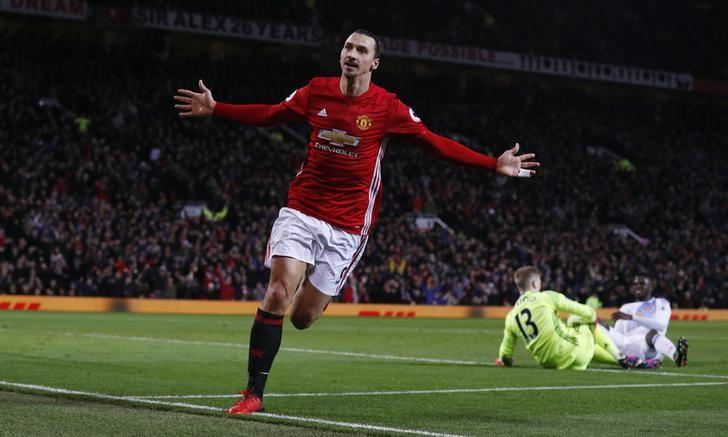 Britain Soccer Football - Manchester United v Sunderland - Premier League - Old Trafford - 26/12/16 Manchester United's Zlatan Ibrahimovic celebrates scoring their second goal as Sunderland's Jordan Pickford looks dejected  Reuters / Phil Noble Livepic