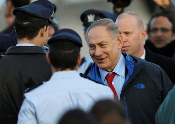 Israeli Prime Minister Benjamin Netanyahu takes part in a graduation ceremony for Israeli air force pilots at the Hatzerim air base in southern Israel December 29, 2016. REUTERS/Amir Cohen