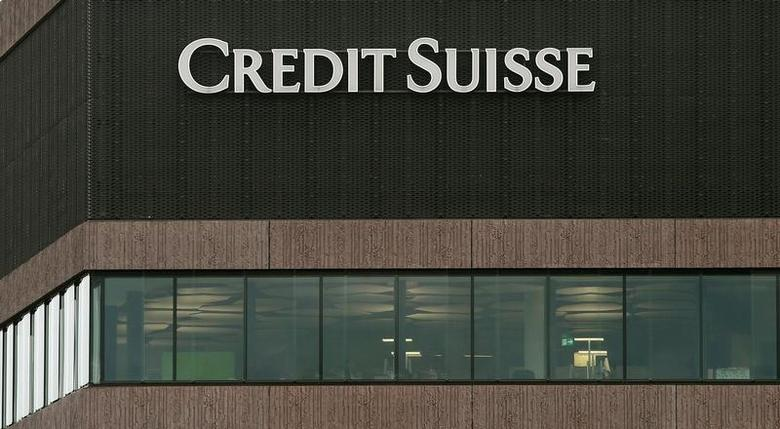 The logo of Swiss bank Credit Suisse is seen on an office building in Zurich, Switzerland, December 23, 2016. REUTERS/Arnd Wiegmann - RTX2W92S