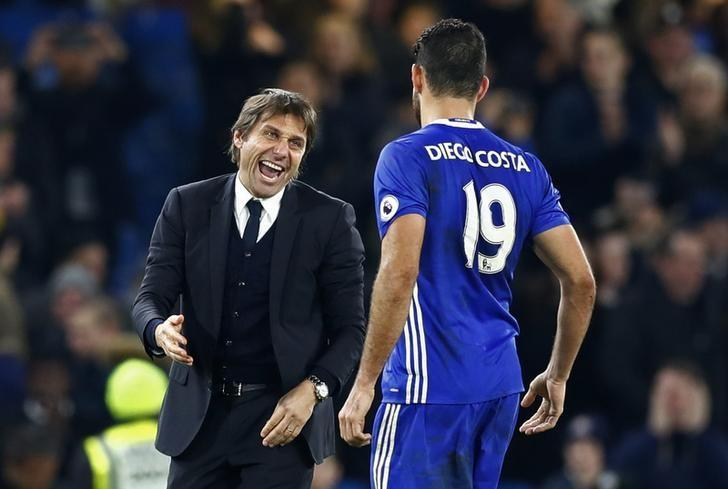 Britain Football Soccer - Chelsea v Stoke City - Premier League - Stamford Bridge - 31/12/16 Chelsea's Diego Costa and Chelsea manager Antonio Conte celebrate after the game Reuters / Eddie Keogh Livepic