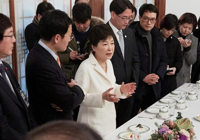 South Korean President Park Geun-hye speaks during a meeting with reporters at the Presidential Blue House in Seoul, South Korea, in this handout picture provided by the Presidential Blue House and released by Yonhap on January 1, 2017.    Blue House/Yonhap via REUTERS