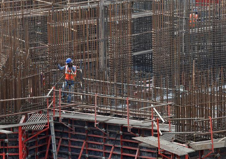 A man works on a construction site of a residential building in Mumbai, India, October 31, 2016. REUTERS/Shailesh Andrade/Files